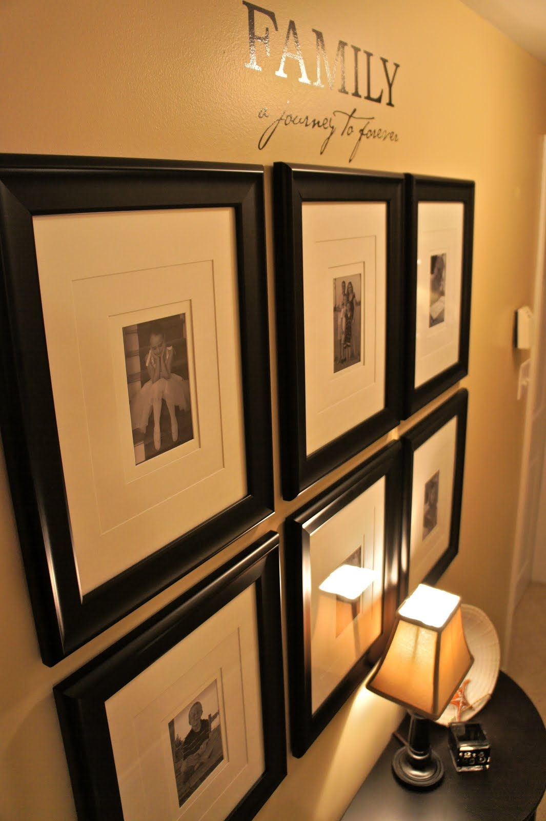 a simple wall grouping is created using inexpensive black frames 15 for 2 from costco with white matting a few favourite family photos printed in black